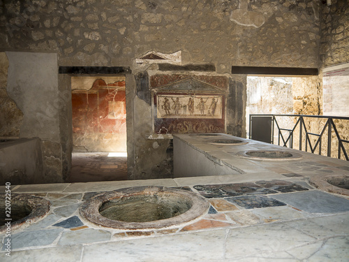 Obraz na płótnie Shop or Bar in the once buried Roman city of Pompeii south of Naples under the s