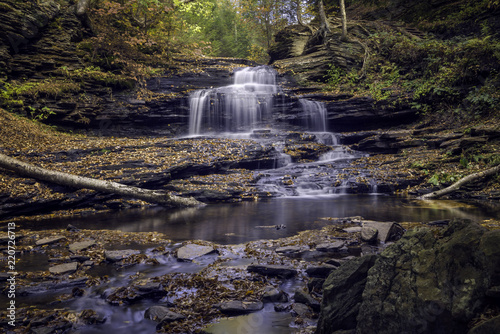 Photo  Autumn Leaves Cover Rocks Surrounding a Waterfall in Ricketts Glen State Park in