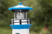 Lighthouse Solar Garden Lamp Closeup, Nobody.