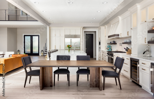 Beautiful Dining Room And Kitchen In New Luxury Home With Partial View Of Living Entry