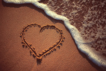 Heart Drawn On The Sand Of A Beach