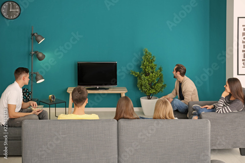 Young people watching movie in home cinema