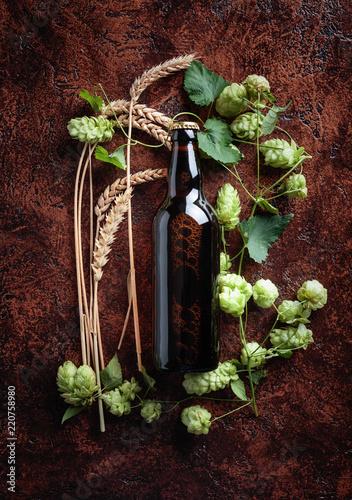 Tuinposter Bier / Cider Bottle of beer, grain and hops on a vintage background.
