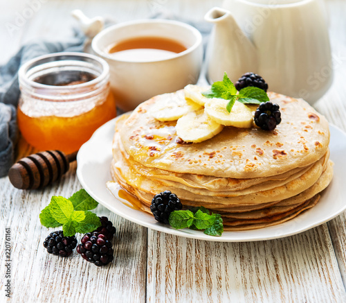 Delicious pancakes with blackberries and bananas