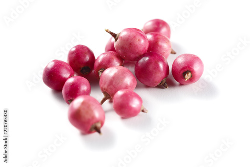 pink peppercorns isolated