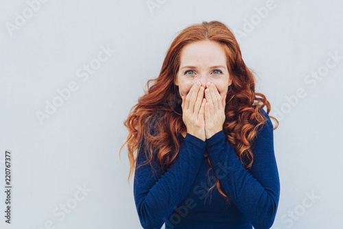 Fotografie, Obraz  Embarrassed young woman covering her face
