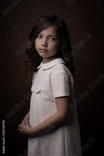 Girl with green eyes in white dress