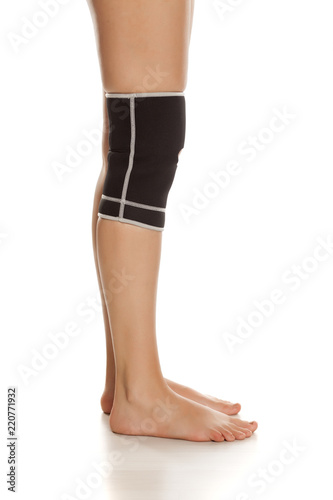 730242716d Female leg with Supportive Orthopedic Wrist on the knee on white background