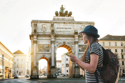 A tourist girl with a backpack looks sights in Munich in Germany Canvas