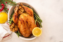 Roast Chicken With Lemons, Garlic And Rosemary For Christmas. Christmas Concept. Top View.