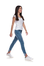 Sexy Casual Woman Wearing A White T-shirt Walking To Side