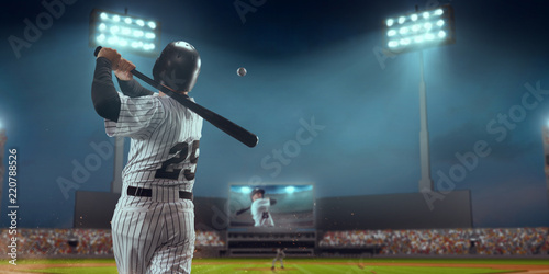 Photo Baseball player bat the ball on professional baseball stadium