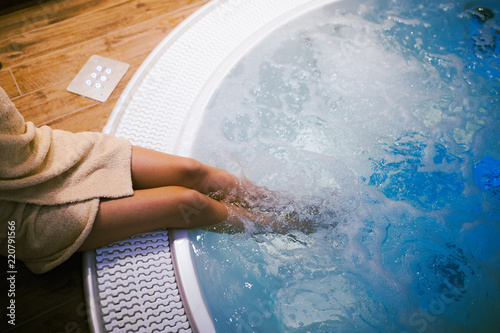 Fototapety, obrazy: Woman entering jacuzzi in spa resost