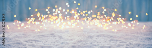 Obraz Abstract magic winter landscape with snow and golden bokeh lights - Banner, Panorama - fototapety do salonu