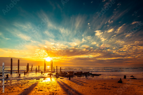Port Willunga beach with jetty pylons at sunset