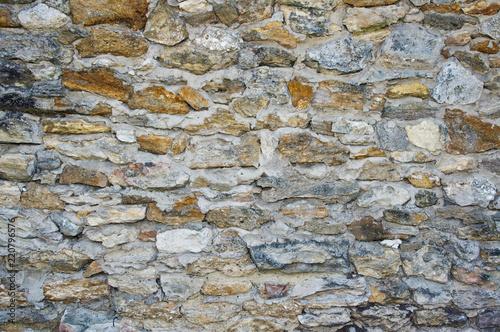 Foto op Plexiglas Wand Texture of an old stone wall. Closeup