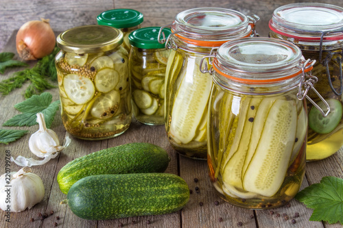 Homemade pickled cucumbers on gray wooden background