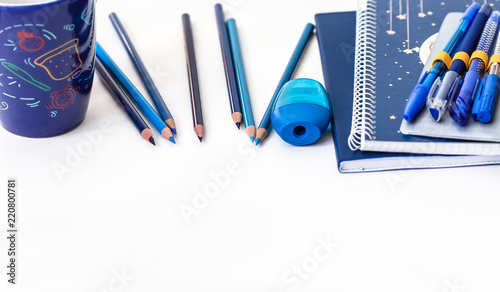 Photo Back to school blue items on white background