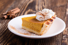 Slices Of Pumpkin Pie With Whi...
