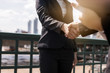 Business woman negotiate and shake hands with partner or investor outdoor on bridge, successful conversation and agreement concept