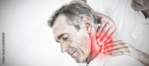 Fotografering Composite image of male chiropractor massaging patients neck