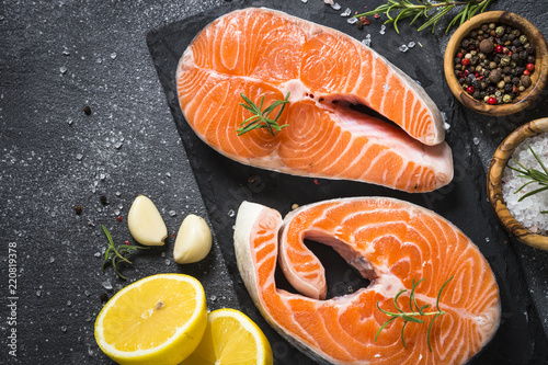 Salmon steak fresh fish with spices top view.