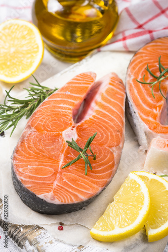 Salmon steak fresh fish with spices close up.