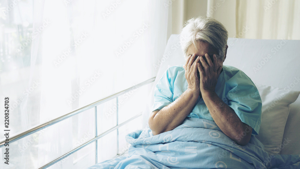 Fototapety, obrazy: Lonely Elderly patients in hospital bed patients want to go home - medical and healthcare concept