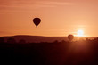 silhoutte of balloon on sunrise. famous hot air balloon flying over valley. Goreme, Cappadocia, Turkey.