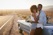 Portrait Of Romantic Couple Enjoying Road Trip In Classic Car