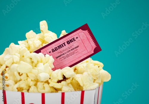 Popcorn food in box and ticket on background