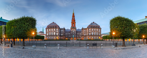 Foto auf Leinwand Skandinavien Panoramic view of Christiansborg, palace and government building, the seat of parliament, during morning blue hour, Copenhagen, capital of Denmark