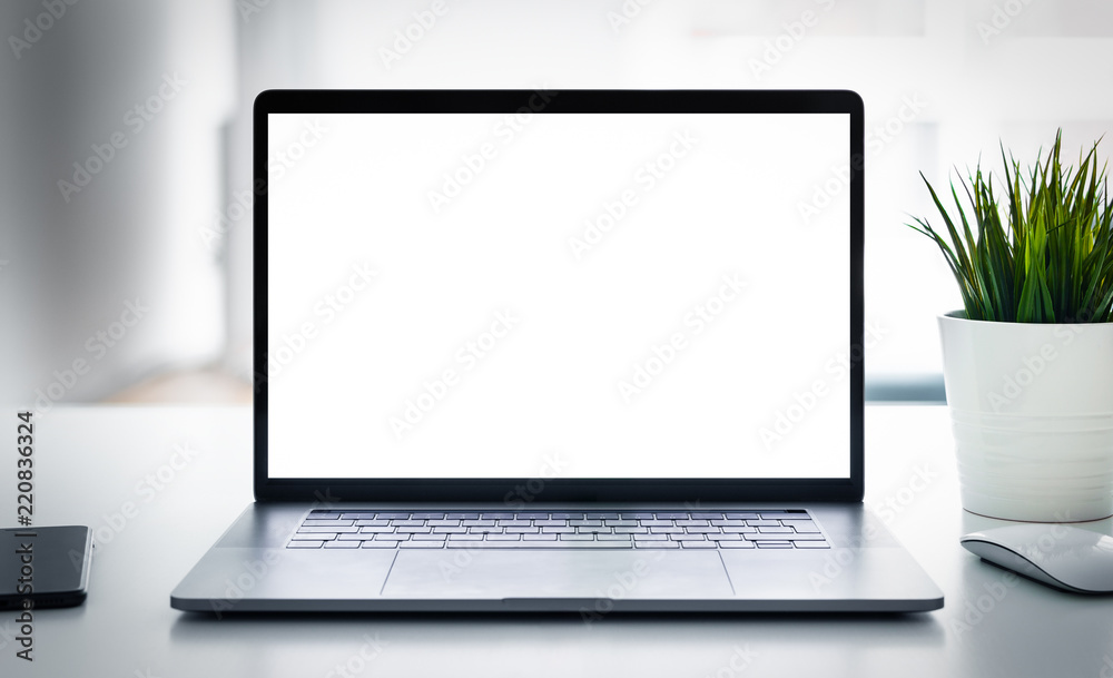 Fototapeta Laptop with blank screen on table