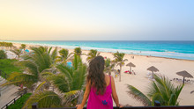 Young Woman Watching The Beautiful Cancun Beach At Sunset, Mexico