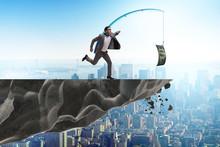 Businessman Chasing Money On F...
