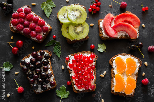 home made sandwiches with berries and fruits close-up