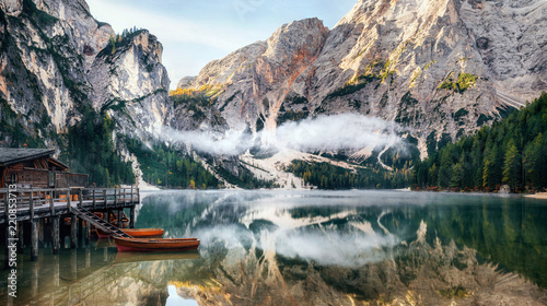 Poster de jardin Lac / Etang Panoramic view of Braies Lake with the hut and boats in Dolomites mountains and Seekofel in the morning, Sudtirol, Italy