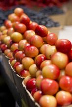 Piles Of Rainier Cherries In A Produce Market