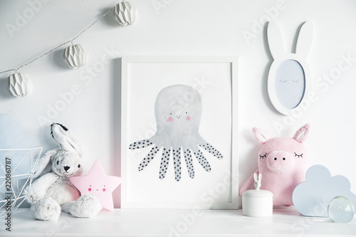Foto  Stylish scandinavian nursery interior with mock up photo frame , white rabbit, pinky pig  and star
