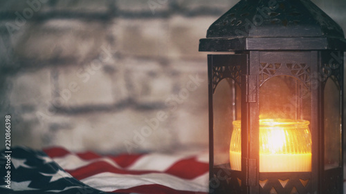 Lighted candle with an American flag, background Fototapet