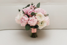 Beautiful Wedding Bouquet For The Bride With Pink Peonies And White Peony Roses