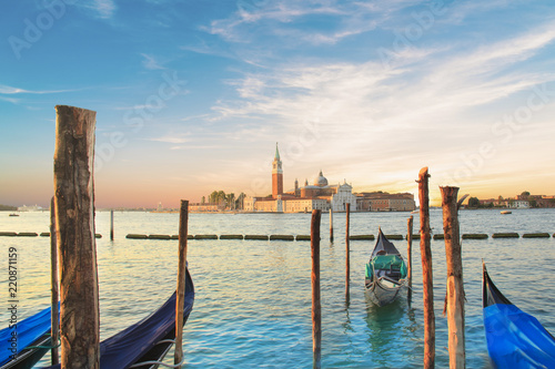 Foto op Plexiglas Venetie Beautiful view of the gondolas and the Cathedral of San Giorgio Maggiore, on an island in the Venetian lagoon, Venice, Italy