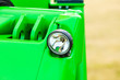 canvas print picture - Reflector on big heavy green vehicle
