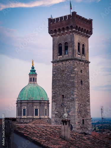 Poster Oude gebouw View of the medieval tower and the dome of the Cathedral in Lonato, Italy.