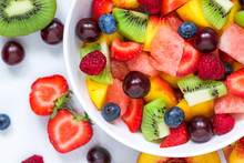 Fruit Salad With Watermelon, Strawberry, Cherry, Blueberry, Kiwi, Raspberry And Peaches In A Bowl On White Background