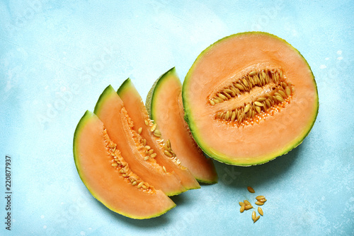 Raw organic tuscan melon cantaloupe.Top view with copy space.