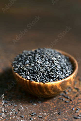 Black sesame seed in a wooden bowl.