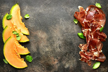 Sliced Melon And Jamon Or Prosciutto.Top View With Copy Space.
