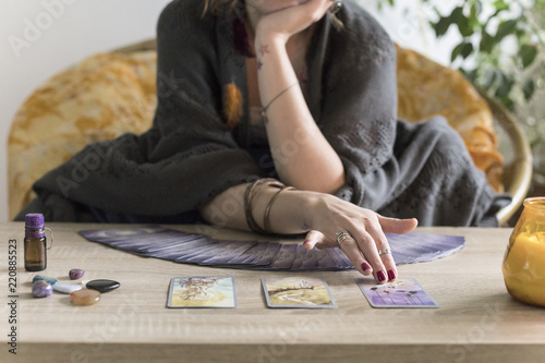 Valokuva Young redheaded woman reading tarot fortune