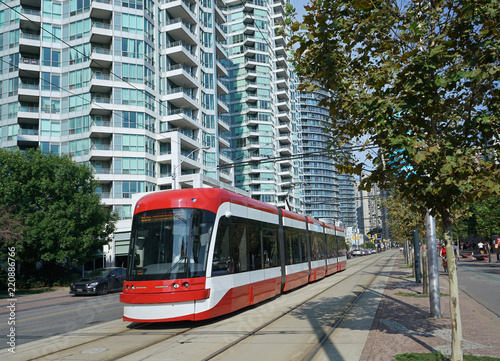 LRT train in waterfront area of downtown Toronto with its own right of way.